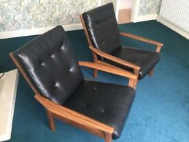 Two original Cintique black leather retro chairs