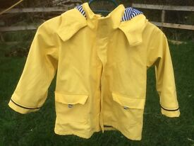 A beautiful yellow rain coat 3-4 yrs