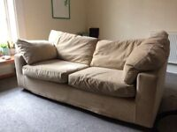 Large beige sofa in good condition