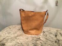 Ladies tan leather bucket handbag, from Zara.