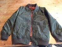 Boys green bomber jacket age 7-8