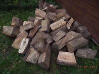 load of seasoned logs