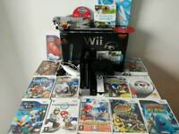 Boxed Nintendo Wii with 15 Games and accessories