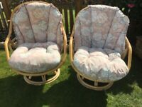 Two Cane swivel chairs