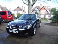 lovely black saab estate with cream leather seats