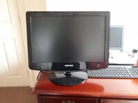A TV (used as a monitor) and a monitor - both for £15