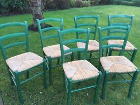 Six green /raffia dining room chairs