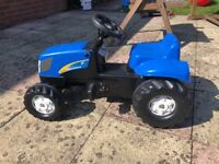 Ride-on pedal tractor £25