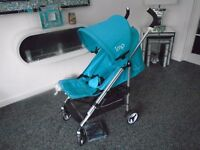Brand new IMP lie flat umberella buggy with new raincover