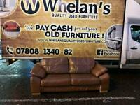 e seater sofa in a thick grade of tan leather Hyde through out