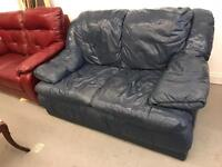 Dark blue leather 2 seater sofa in good condition