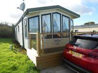 Willerby Aspen static caravan sited at Greenfields Holiday Park, West Wales. 2 beds, CH. DG