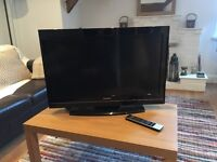 "32"" TV with remote control"
