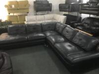 Large Italian black leather corner sofa