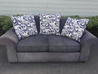 Dark grey suede/fabric sofa. Can deliver