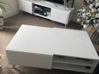 Matching white gloss tv unit and table