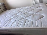 Hardly used sprung double mattress