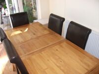 Extending Solid Oak Dining Table & 6 Faux Leather Chairs