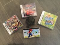 Nintendo DS in white (Mario branded), along with 3 games