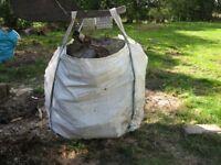 Firewood, builders bag of seasoned hardwood.