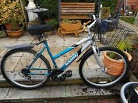 ladies blue and silver 18.5 inch frame magna bike with basket and lock