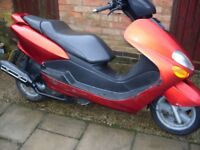 Yamaha scooter 125 cc 12 months mot no advisories ride away reduced price space needed.