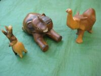 Three Carved Wooden Elephant Ornaments