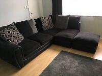 Black corner sofa and foot stool