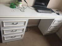 nice dress desk with multiple draws in a good condition for £10