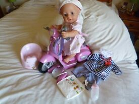 Baby Born interactive Doll , remote scooter, bottle,dummy,musical potty,outfits