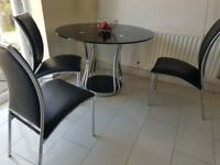 Glass table and four chairs paid £450