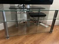 "Glass TV stand can hold up to 55"" TV"
