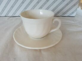 17 cups and saucers. (as in picture)