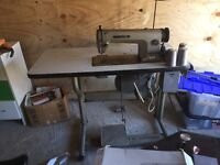 Mistibushi sewing machine in full working order. Table included. Foot pedal operated