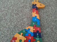 Wooden jigsaw puzzle. Alphabet and numbers on reverse. colourful. Literacy and numeracy resource