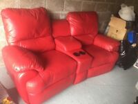 As good as new 2 seater red leather sofa independently electrically reclined
