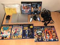 PS2 silver slim console + games