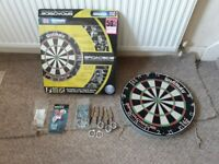 Dartboard and new set of darts
