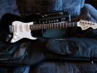 Squier by Fender Affinity Stratocaster, black with a Fender Frontmans 15G Amp