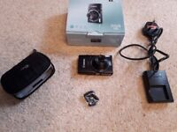 Canon Ixus 155 camera in EXCELLENT condition with charger, case, strap and 2GB memory card