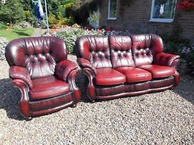 Two piece leather settee and chair