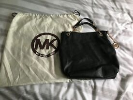Authentic Michael Kors black handbag with gold chains