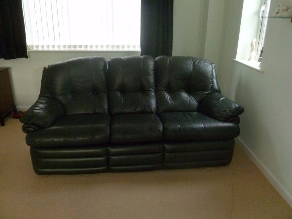 Two Sofa S In Dark Green Leather In Hadleigh Suffolk