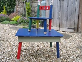 Children's table and chair set. Lovely bright colours. Pencil legs on table and chair.