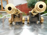 2 brass canons on wooden frames, desk ormanents