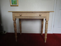 small pine table, with nicely turned legs. Good vintage piece. Will take £25 only.