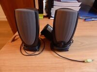 A pair of dell computer speakers