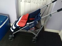 Mamas and papas pushchair with swivel wheels lay back position seat shopping basket used once ex con