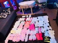 Moses basket and newborn girls clothes