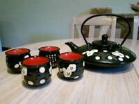Ceramic teapot and 4 matching insulated cups. Black and red Chinese design